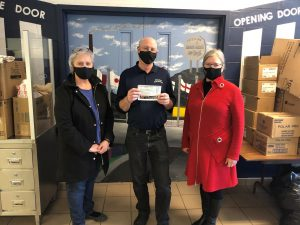 two women stand with man wearing COVID 19 face masks