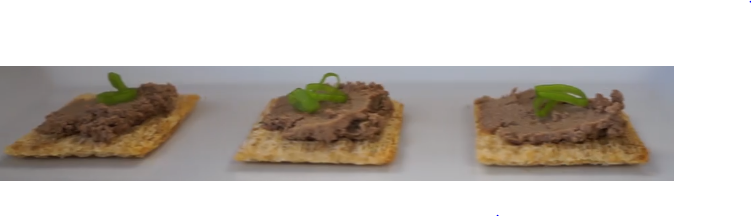 three crackers, liver pate spread on the crackers in a row