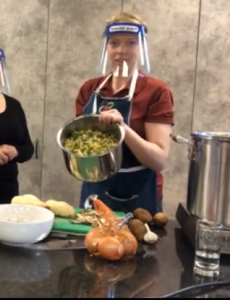 two people making soup